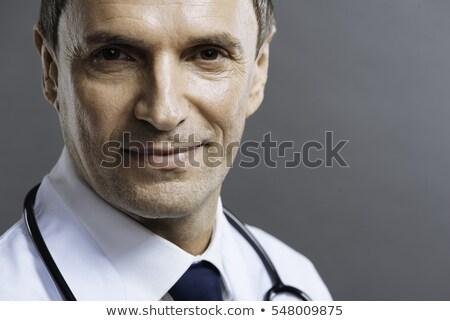 fiatalember · mosolyog · kamera · közelkép · fiatal · szakállas - stock fotó © deandrobot
