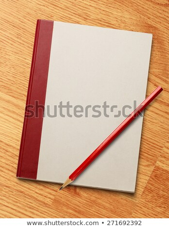 Closed red book and wooden pencil on white background. Isolated  Stock photo © ISerg