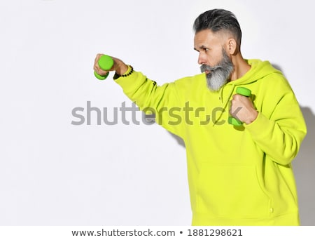 Man does boxing workouts at the gym Stock photo © alphaspirit