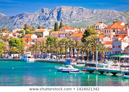 Turquoise waterfront and colorful boats in town of Cavtat Stock photo © xbrchx