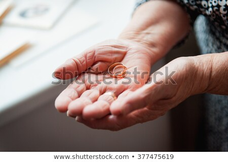 Hand 86th-years old Ukrainian women holding ring Stock photo © ruslanshramko