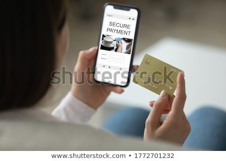 Afbeelding tevreden vrouw mobiele telefoon creditcard Stockfoto © deandrobot