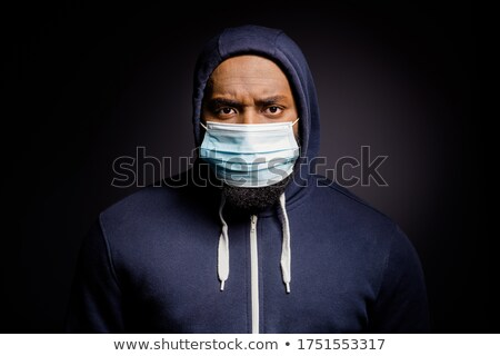 Portrait of unhappy african american guy wearing sweater and sca Stock photo © deandrobot