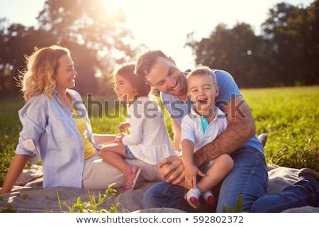 Stockfoto: Gelukkig · gezin · park · vrouw · meisje · gras