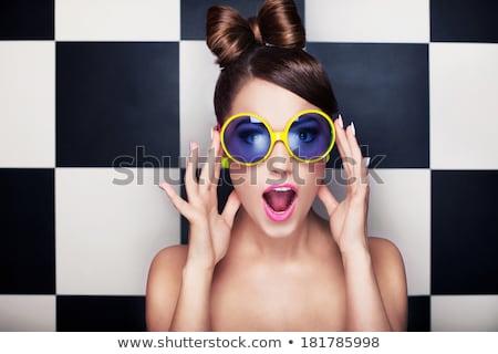 Megrémült fiatal nő visel póló izolált kék Stock fotó © deandrobot