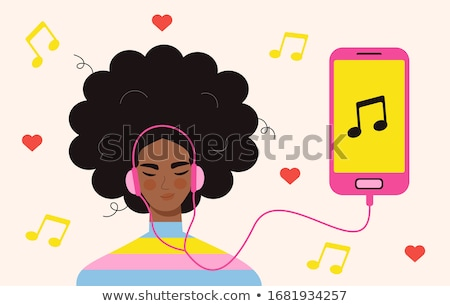 teenage girls listening to music from smartphone stock photo © dolgachov