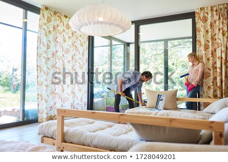 Woman as homemaker at spring clean working on the windows Stock photo © Kzenon