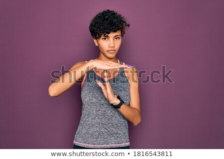 Portrait of a confident young african sportswoman Stock photo © deandrobot