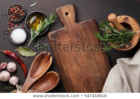 Stock photo: Cooking wooden utensils, condiments and spices