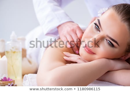 Woman during massage session in spa Stock photo © Elnur