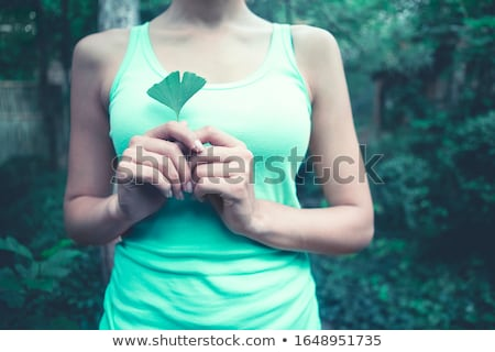Lady with ginkgo biloba leaf Stock photo © dashapetrenko