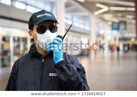 Guardia de seguridad cara máscara hablar edificio Foto stock © AndreyPopov