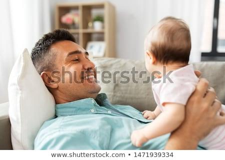 Orta yaşlı baba oynama bebek ev aile Stok fotoğraf © dolgachov