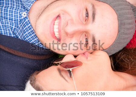 Couple laying in fallen leaves Stock photo © photography33