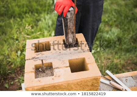 Man building a concrete post Stock photo © photography33