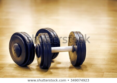 Serie of dumbbells in a row at gym Stock photo © RuslanOmega