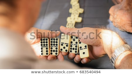 Man playing with dominoes Stock photo © photography33