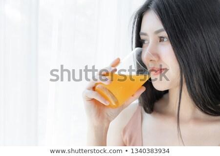 Woman drinking glass orange juice Stock photo © photography33