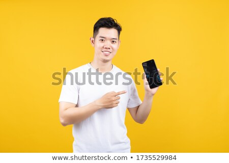charming business man offering a mobile phone stock photo © pablocalvog
