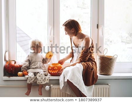 Woman carving pumpkins with her child Stock photo © photography33