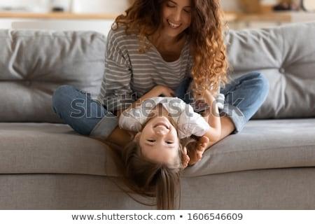 Mãe jogar filha de cabeça para baixo menina Foto stock © dacasdo