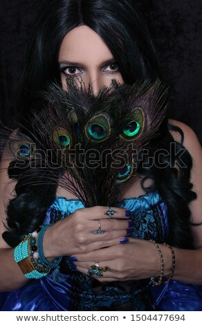 Attractive Brunette Woman Gypsy Costume Feathered Face Mask Fashion Stock photo © cboswell