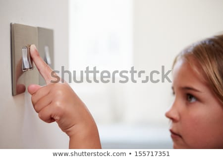 Young Girl Turning Off Light Switch Stock photo © monkey_business