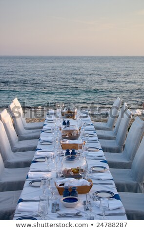 White tables served for supper on beach. Stock photo © kyolshin