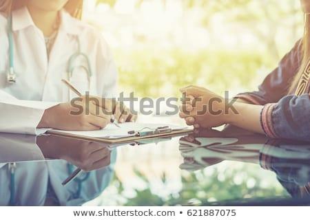 asiático · paciente · consulta · feminino · médico - foto stock © kzenon