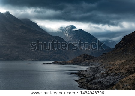 Clear Water With Misty Mountain Stock photo © jameswheeler