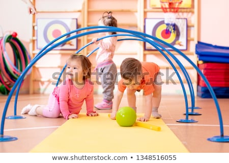 Infant in baby gym Stock photo © naumoid