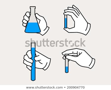 chemical test tube in hand  Stock photo © OleksandrO