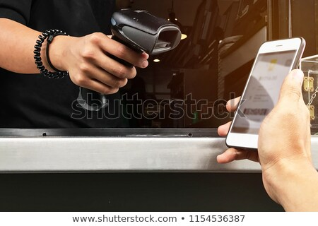 Cashless society concept, man using smartphone for electronic pa Stock photo © stevanovicigor