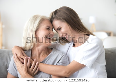 Mother and daughter laughing together Stock photo © IS2