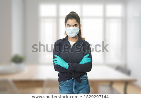 standing woman wearing latex clothes Stock photo © phbcz