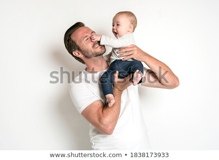 baby picking nose of father stock photo © is2