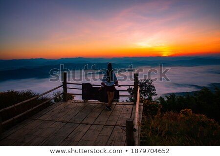 Man sitting in front of a glacier Stock photo © IS2