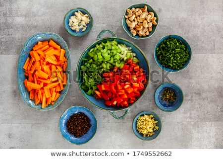 arrangement of spices in small bowls stock photo © dash