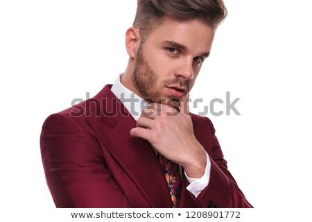 Portré csábító férfi öltöny gondolkodik áll Stock fotó © feedough
