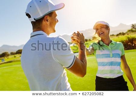 Feliz casal campo de golfe homem olhando namorada Foto stock © Kzenon