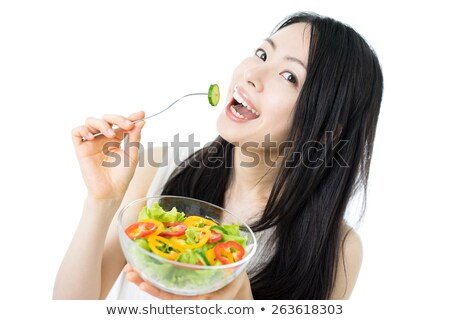 Cute black hair girl eating lettuce Stock photo © boggy