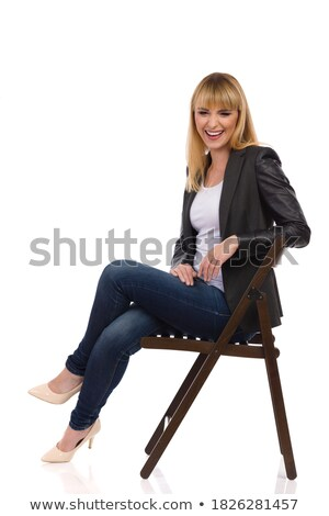 relaxed businesswoman sits on chair cross-legged and laugh Stock photo © feedough
