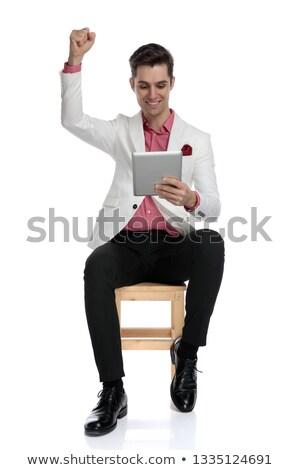 エレガントな 男 座って 読む 良いニュース タブレット ストックフォト © feedough