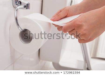 Hand toiletpapier badkamer man Stockfoto © AndreyPopov