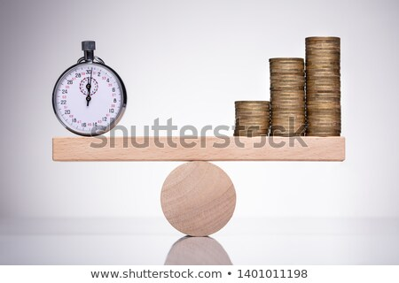 Stop Watch And Stack Of Coins On Scale Stock photo © AndreyPopov
