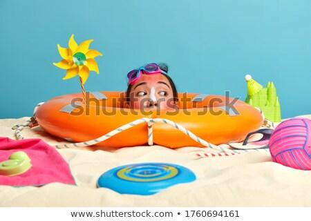 summer woman swimming wearing lifebuoy seaside stock photo © robuart