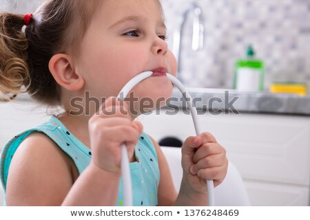 Girl Biting Cable Stock photo © AndreyPopov