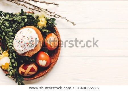 basket with Easter cakes and colored eggs Stock photo © mayboro