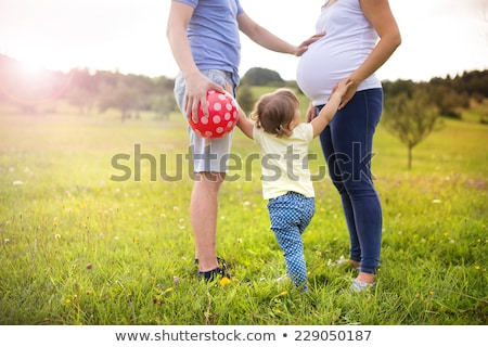 expecting pregnant woman and child daughter playing and having f stock photo © lopolo