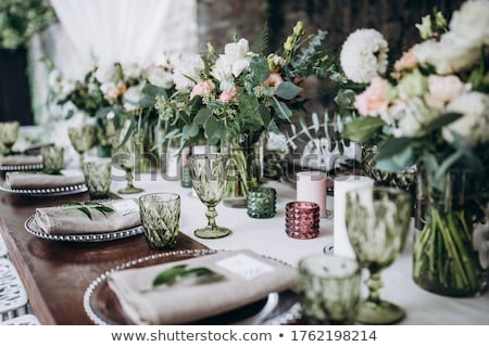 Wedding banquet tables with flowers decoration Stock photo © boggy